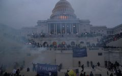 Police officers stand guard as supporters of U.S. President Donald Trump gather in front of the U.S. Capitol Building in Washington, U.S., January 6, 2021. REUTERS/Leah Millis     TPX IMAGES OF THE DAY